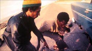 Bob Marley changing a tyre in Trinidad