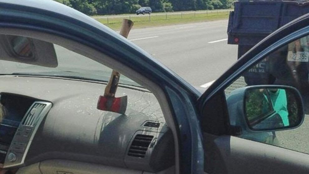 PHOTO: Motorists were startled when an axe from a dump truck in front of them flew at their windshield.