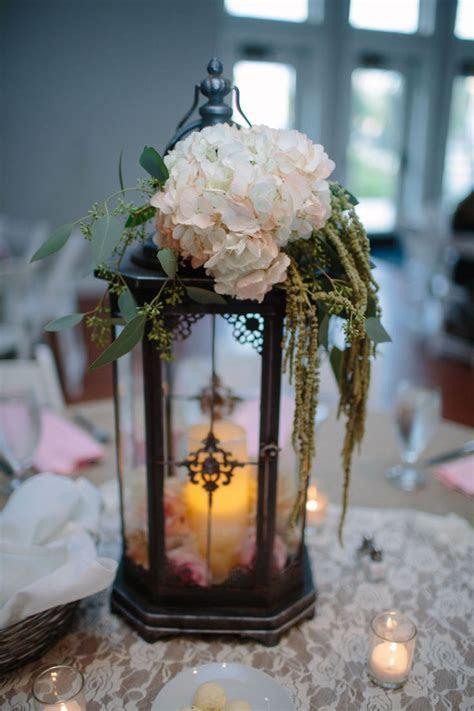Tall lantern centerpiece  hobby lobby   Wedding