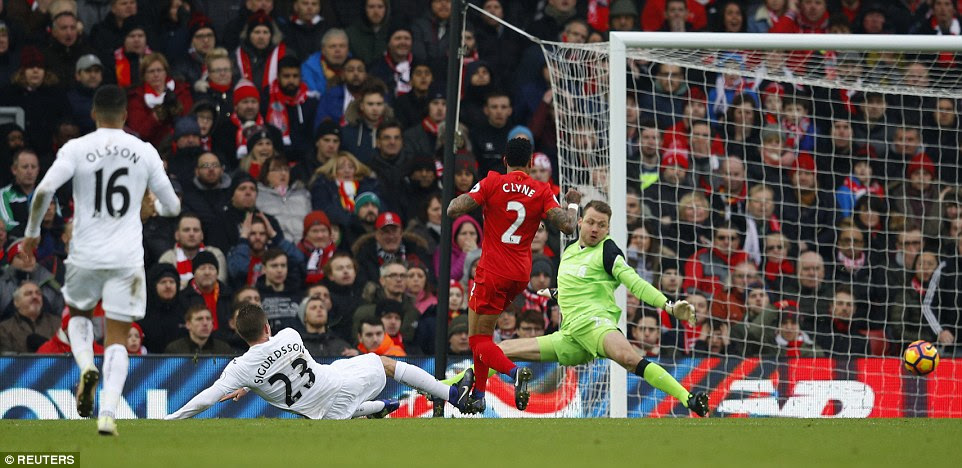 Gylfi Sigurdsson pokes home Swansea's third goal at Anfield as the visitors restore their narrow lead over Liverpool