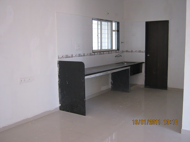 Kitchen platform and the door of dry terrace in the 2 BHK Flat of Alliance BellAir - Ready Possession Flats - in Ram Indu Park, Baner, Pune 411 045