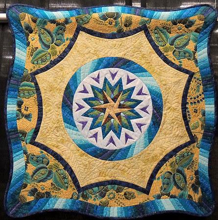 Teal Starburst by Janet Massey, Hoffman Challenge