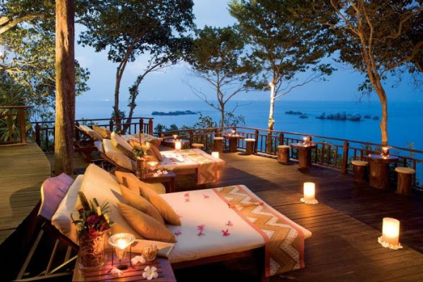romantic lounging on the deck by lantern light with views
