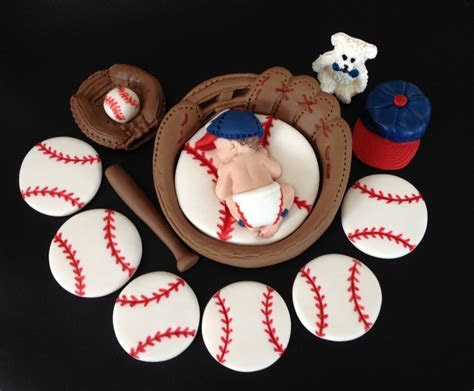 Fondant baby boy baseball inside a 3D glove cake topper in