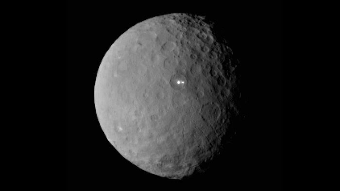 An image of Ceres taken by NASA's Dawn spacecraft shows that the brightest spot on the dwarf planet has a dimmer companion.