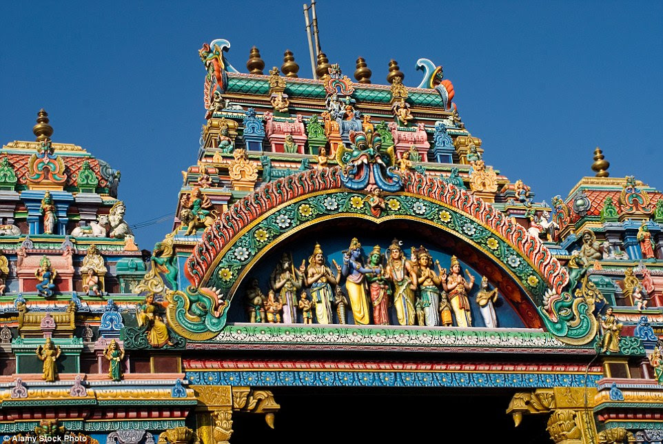 For now though, the rainbow temple catches the attention of thousands of visitors who flock to the Hindu site for blessings