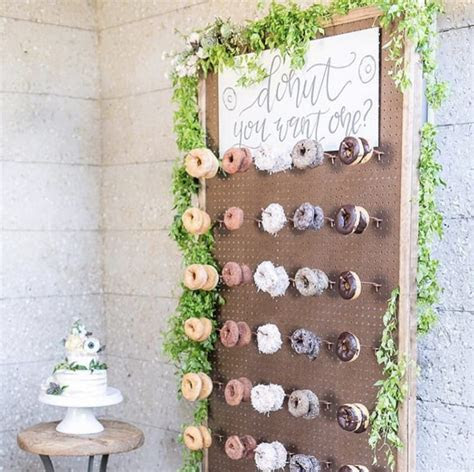 Bride Hangs Doughnuts On Wooden Board To Create The Most