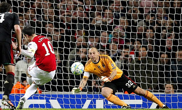Van the man: Arsenal's leading goalscorer made it three for the Gunners from the spot (and below)
