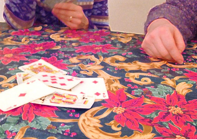 Women Playing Cards on New Year's Eve