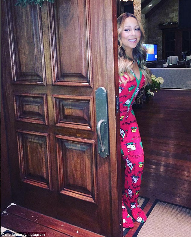 Christmas costume: The 45-year-old dressed in festive sleepwear, as did her children
