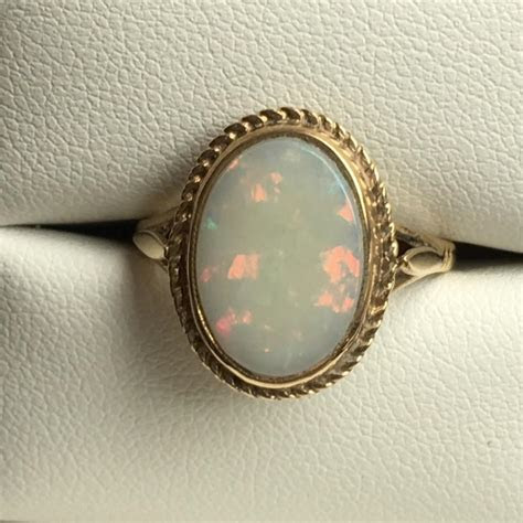 Vintage Opal Ring. 3 Carat White Opal In 9K Yellow Gold