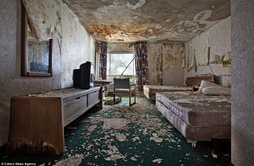 In this more modern hotel room, the walls and ceiling are deteriorating rapidly while the plastic in the television set still looks new; plastic does not biodegrade like other materials