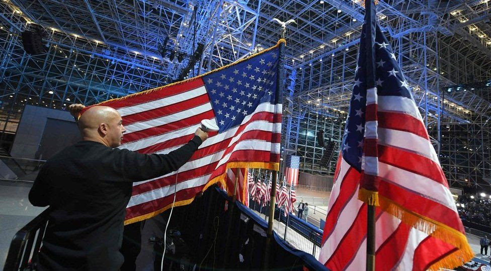 A worker prepares a US flag at the Jacob K Javits Convention Center in New York