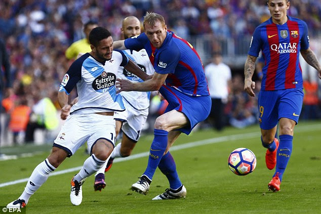 Jeremy Mathieu of Barcelona gets to grips with visiting forward Florin Andone