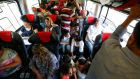 Travellers sit in a train with migrants en route to Vienna from Budapest. Photograph: Laszlo Balogh/Reuters