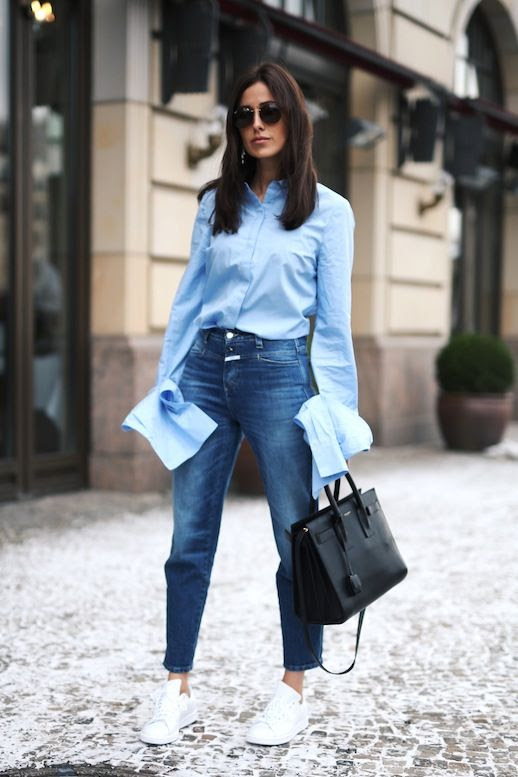 Le Fashion Blog Blogger Style Sunglasses Blue Button Down Shirt With Extra Long Sleeves High Waisted Jeans Black Saint Laurent Bag White Sneakers Via Sylvia Haghjoo