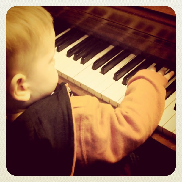 My cousin's baby playing around on the piano