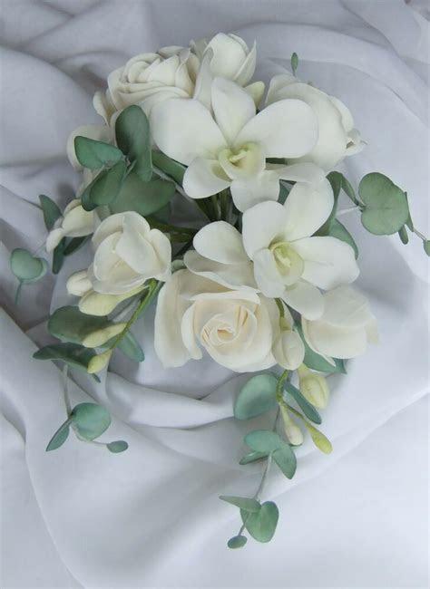 sugar roses orchids freesias eucalyptus flower spray cake