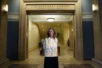 Kim Bancroft poses for a portrait in the Bancroft Library, which her family founded,  on the UC Berkeley campus in Berkeley, CA, Tuesday May 13, 2014.