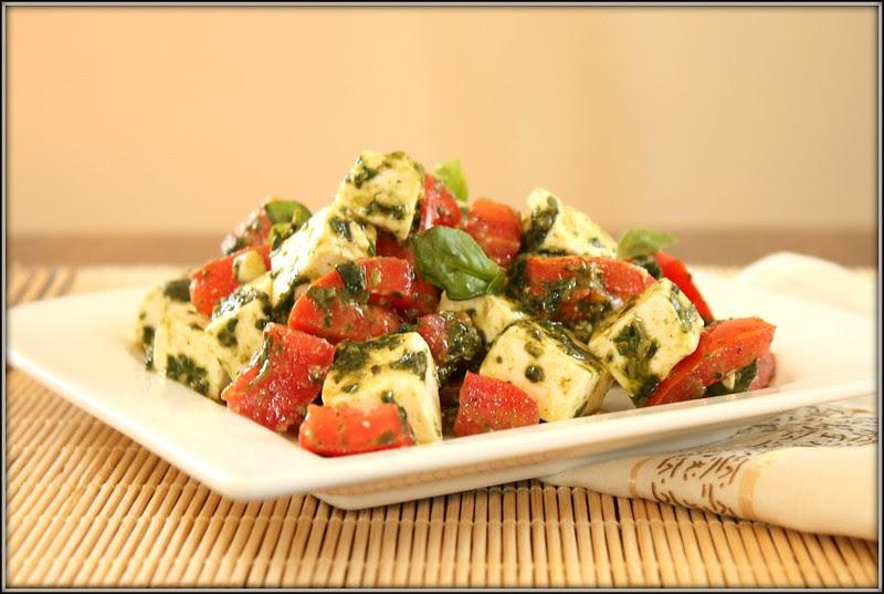 feta and tomato salad in a basil vinaigrette