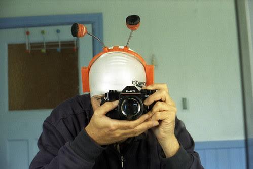 reflected self-portrait with Fuji STX-2 camera and Halloween headgear by pho-Tony