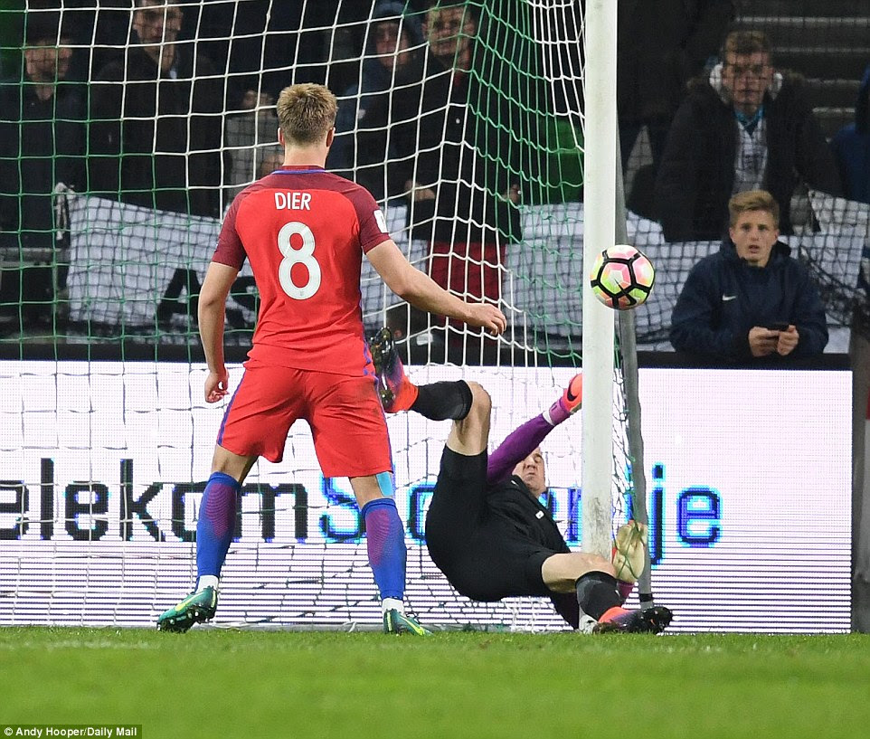 Hart managed to keep the ball out with his left and then right hands, before collapsing into the side of his netting
