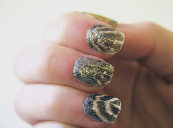 67eaa8d89d59b851_feather-nails-3-xxxlarge_1
