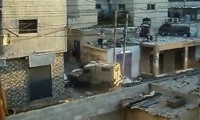 Palestinians throw  objects at Israeli security vehicle in Kalandiya, August 26 (YouTube  screenshot)