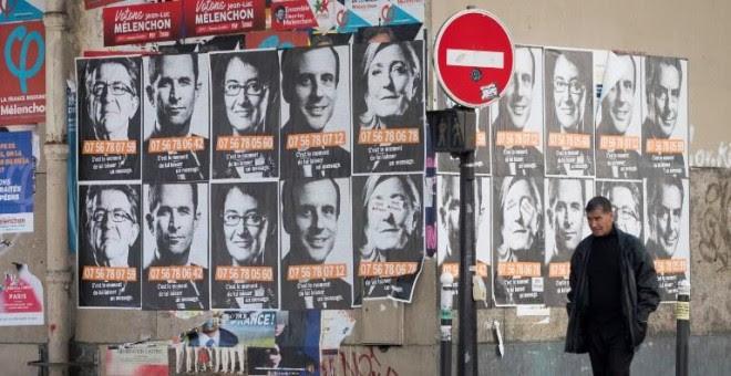 Fotografías de los candidatos presidenciales franceses en París. - AFP