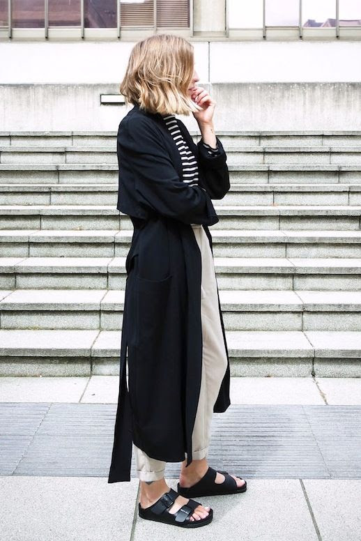Le Fashion Blog Black Long Trench Coat Striped Tee High Waisted Crop Pants Birkenstocks Sandals Via Brittany Bathgate