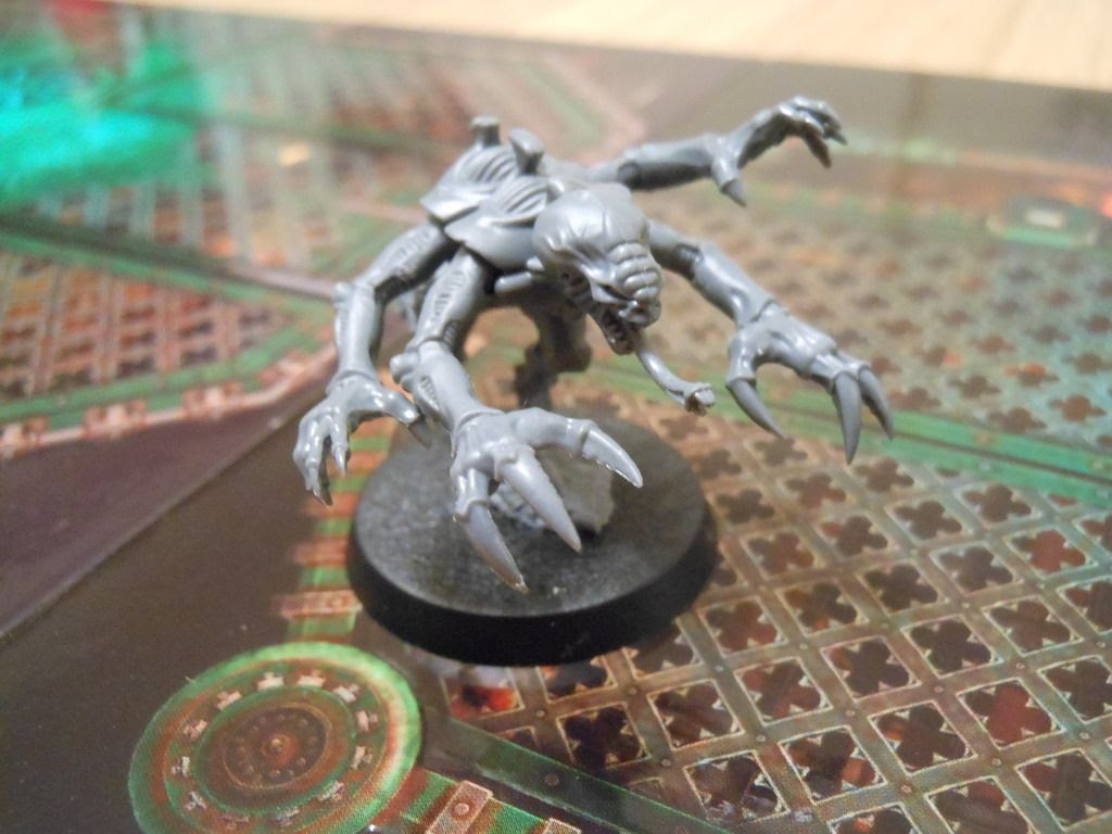 Close up view of the purestrain genestealer miniature from Deathwatch: Overkill.