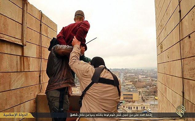 Images from ISIS purport to show two men being thrown from a tall building in Nineveh, Syria- their crime was being gay