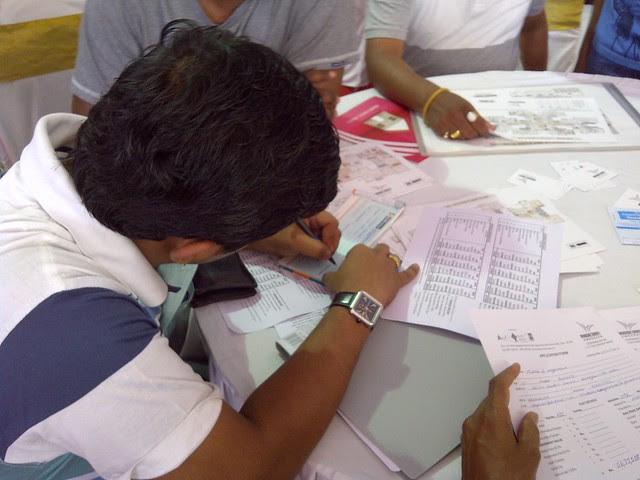 Writing a cheque of booking amount! - Visit Windsor County, 1 BHK 2 BHK & 3 BHK Flats near Reelicon Garden Grove, Datta Nagar, Ambegaon Budruk, Pune 411046