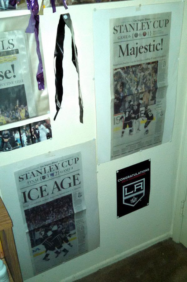 The Los Angeles Times sports pages commemorating the L.A. Kings' Stanley Cup wins from 2012 and this year, respectively.