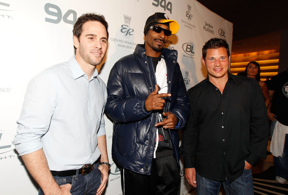 (L-R) NASCAR driver Jimmie Johnson, rapper Snoop Dogg and singer/TV personality Nick Lachey attend the Super Skins Kick Off Party at Hotel 944 featuring Snoop Dogg at The Eden Roc Renaissance Miami Beach on February 4, 2010 in Miami Beach, Florida.
