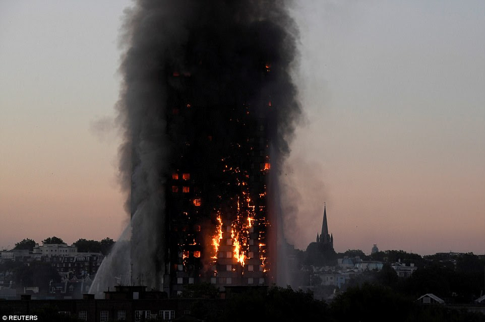 Flames and smoke billow as firefighters deal with the fire at Grenfell Tower apartment block in Latimer Road, West London, on June 14, when 71 people were killed in the blaze. The 24-storey tower block sat in the affluent borough of Kensington and Chelsea