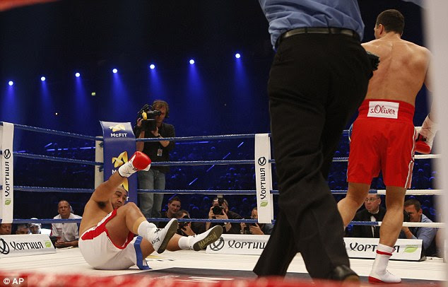 Down you go: Klitschko watches as Leapai falls to the canvas