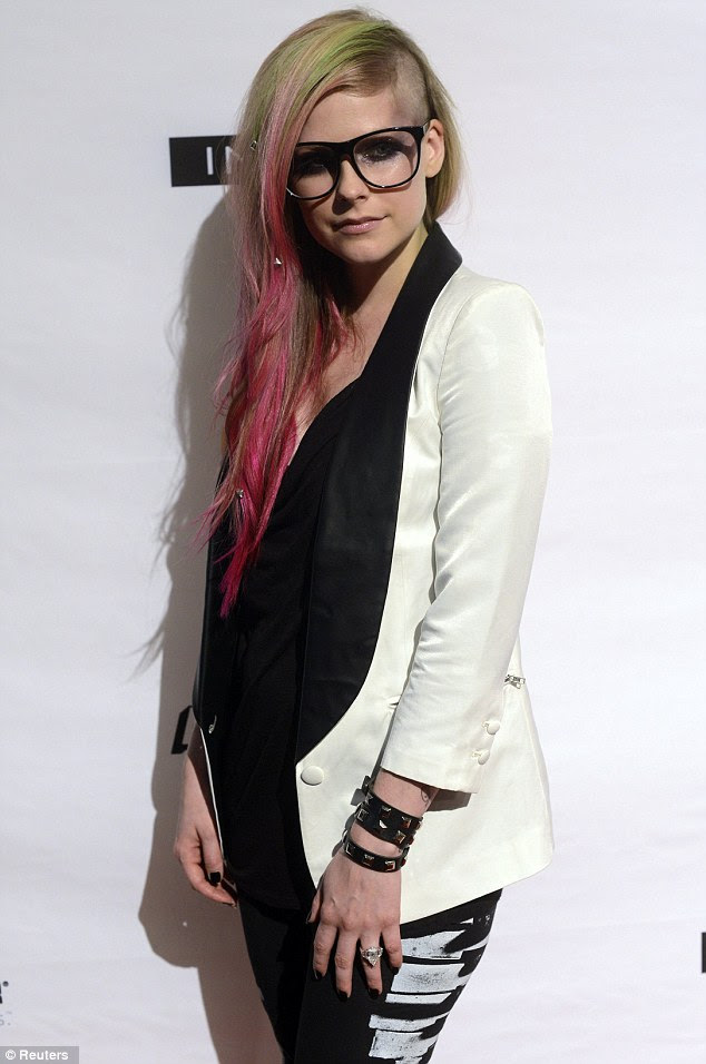 Geek chic: The singer and designer wore oversized spectacles