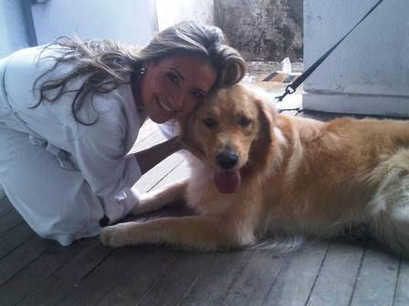 Natalia não esconde a alegria de ter dividido o set com um cachorro