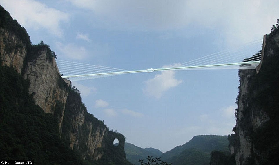 The dizzying walkway is suspended between two cliffs in the Zhangjiajie Grand Canyon area with unbeatable views of the national park