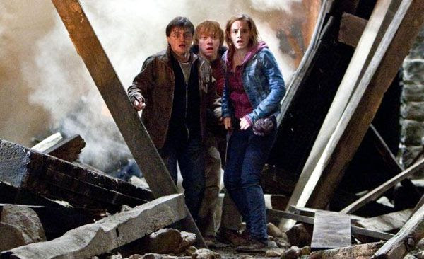 Harry Potter, Ron Weasley and Hermione Granger look out for trouble in HARRY POTTER AND THE DEATHLY HALLOWS, Part 2.