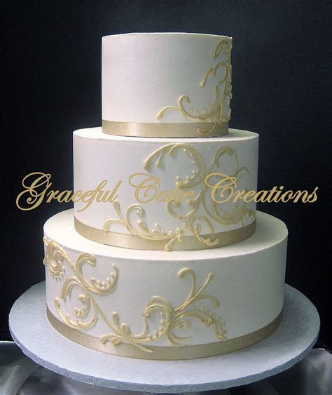 Elegant Ivory Butter Cream Wedding Cake with a Champagne