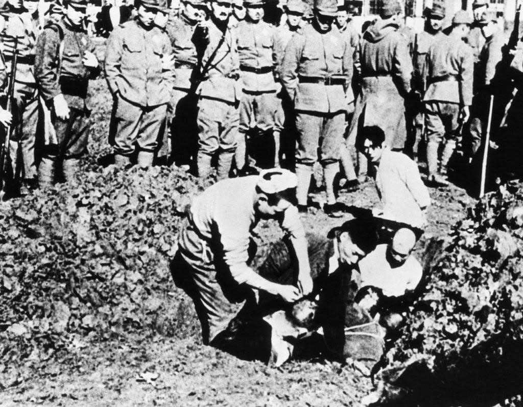 Chinese prisoners being buried alive by their Japanese captors outside the city of Nanking, November 1938