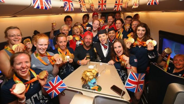 Paralympians drink champagne before takeoff