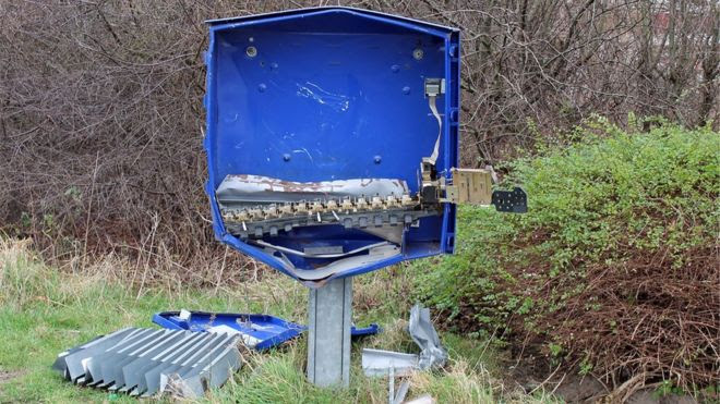 The remains of a condom dispenser after an explosion in Schoppingen, Germany