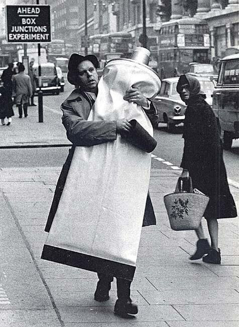 Artist Claes Oldenburg with a monumental tube of toothpaste, London. 1966