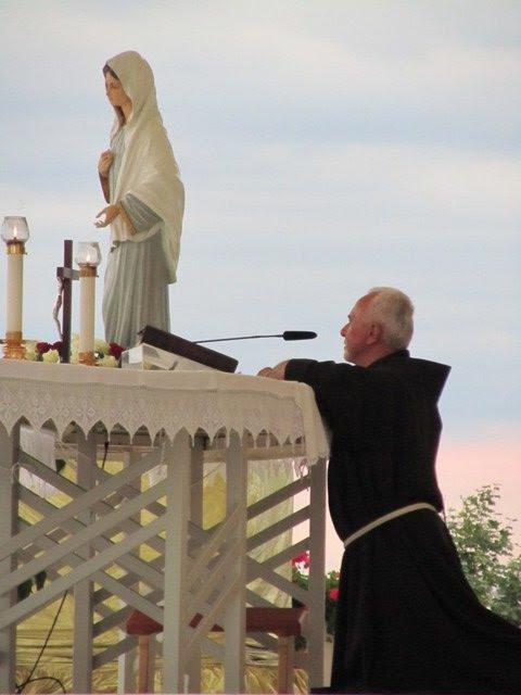 Priest at altar praying