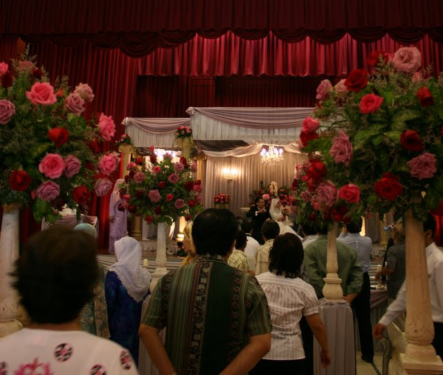 Bersanding - the wedding couple is seated on the ceremonial dias