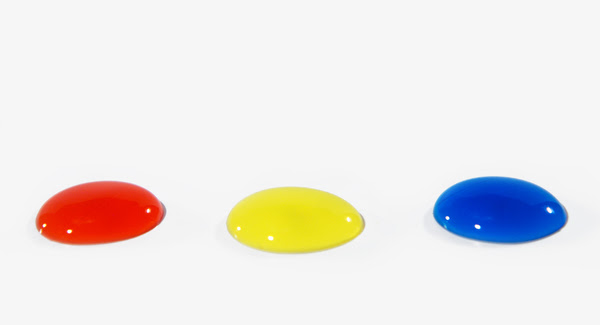 Primary Coloured Drops: Red, yellow, and blue drops of water.