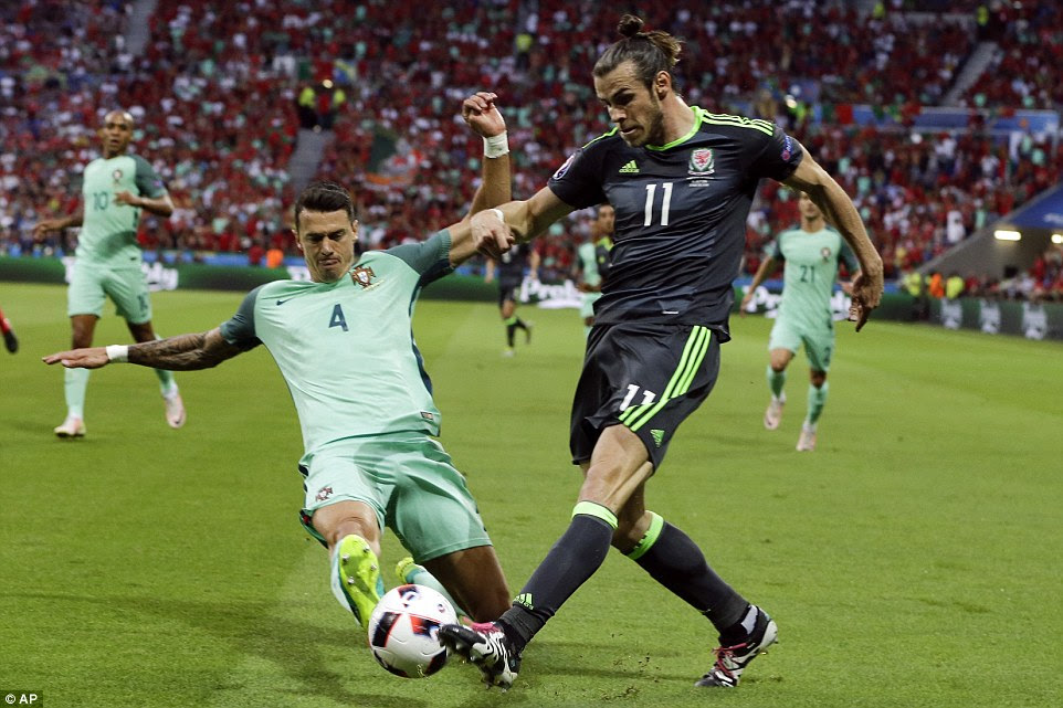 Bale's delivery into the penalty area is blocked by Portugal defender Fonte in a first half that generally lacked action